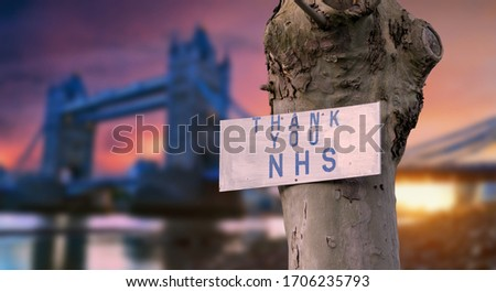 Thank you NHS sign with London sunset city blurred background during coronavirus pandemic in the UK