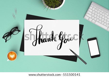 Thank you on paper with smart phone coffee and keyboard