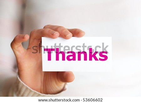 thank you or thanks concept with hand word and paper
