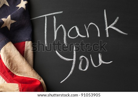 Thank you sign on a chalkboard with vintage American flag