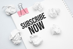 Thank you Subscribe Now. Blank sheet of paper, red paper clip, word Ideas and crumpled paper wads