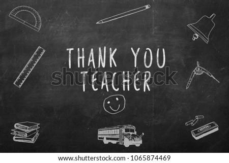 Thank you teacher handwritten on a chalkboard