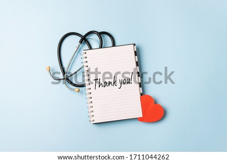 Thank you to doctors, nurses, medical workers. HAPPY NURSES DAY background, banner. International Nurses Day Healthcare and medical concept with notebook, red heart and stethoscope
