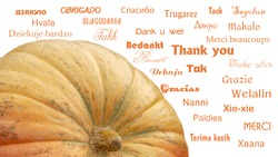 Thank You word in different languages, concept background, near a big pumpkin as a symbol of Thanksgiving Day