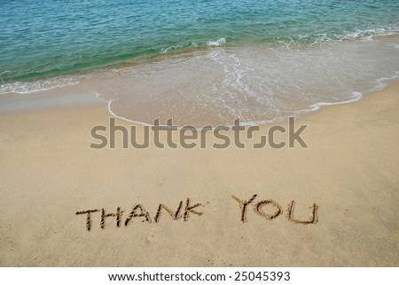Thank You written in a sandy beach