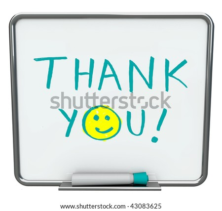 Thank you written on a white dry erase board with blue marker