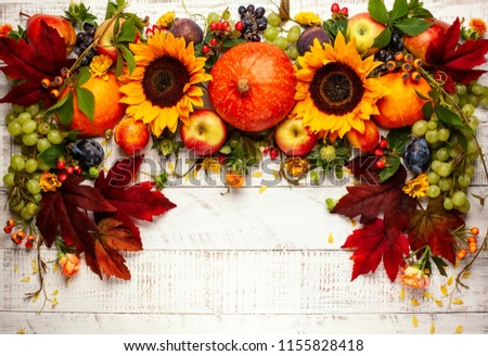 Thanksgiving background with autumn pumpkins, fruits and fall leaves on wooden table. Top view, autumn concept with copy space. #1155828418