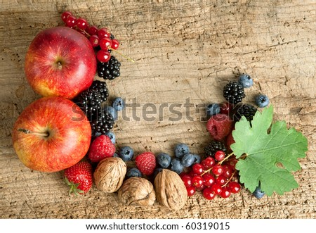Thanksgiving border made of autumn fruits on a wooden board