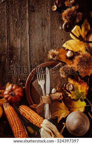 Thanksgiving Dinner Autumn Fruit With Plate And Cutlery Background 324397397