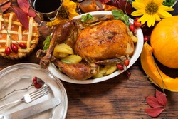 Thanksgiving dinner served on wooden rustic table