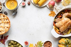 Thanksgiving dinner with chicken, apple pie, pumpkin soup brussel sprouts and fruits. Traditional autumn food concept. Flat lay.