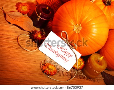 Thanksgiving holiday, pumpkin border still life decoration with candles on the wooden table background, greeting card with text space, harvest concept