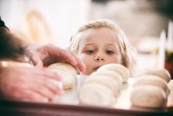 Thanksgiving: Little Girl Hungry For Baked Rolls