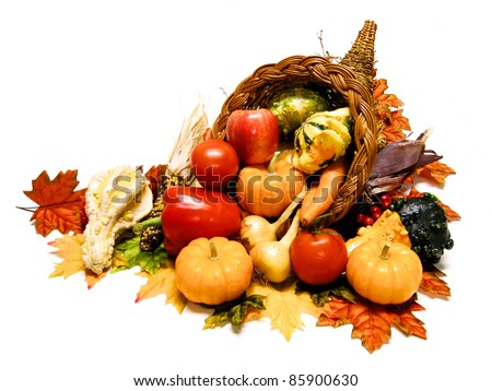 Thanksgiving or harvest cornucopia over a white background