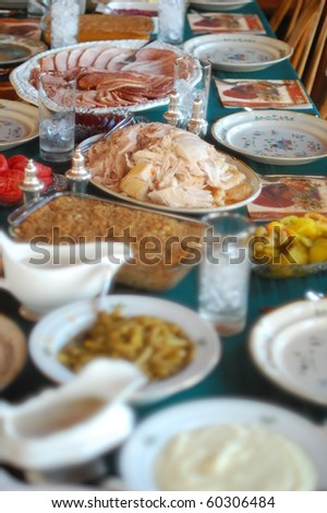 Thanksgiving table with turkey, ham, gravy Mashed potatoes and all the fixings.