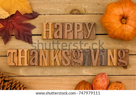 Thanksgiving Themed Background on a Wooden Board - Shutterstock ID 747979111