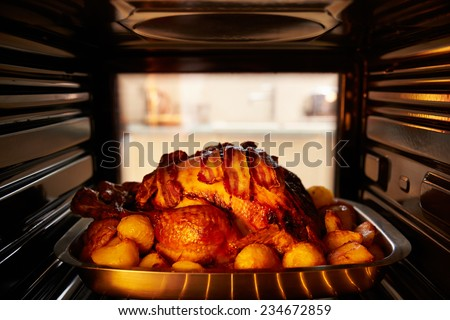 Thanksgiving Turkey Roasting Inside Oven