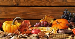 Thanksgiving - Vegetable And Fruits On Straw In Front Of Old Weathered Wooden Boards With Copyspace.
