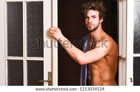 That was great night. Guy attractive lover posing seductive. Sexy macho tousled hair coming out bedroom door. Seductive lover full of desire. Man lover near door. Sexy bachelor lover concept.