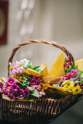 Thatch basket full of colorful flowers in cafe restaurant