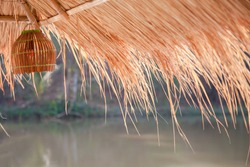 Thatch lamp Hanging on the floating house in thailand Countryside . farmer's plot garden field Concept .