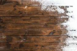 Thaw on the wooden floor terrace in the backyard.