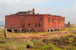 The abandoned brick building in the tundra. Abandoned Prison-forward
