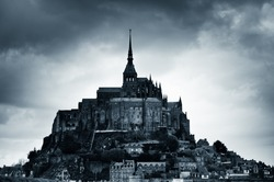 The abbey of Mount Saint Michel island, France, blue colores black and white