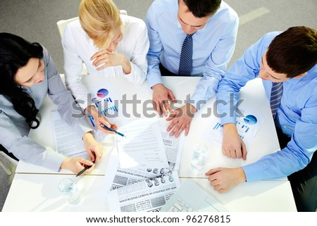 The above view of a business team working with documents
