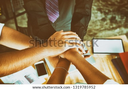 The abstract art design background of  business group hands stacked together,joining teamwork concepts,collaborate project,union and togetherness,blurry light around