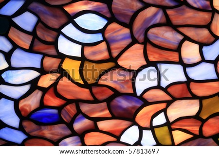 The abstract background consisting of multi-coloured glass fragments