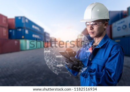 The abstract image of engineer point to the hologram on his smartphone and blurred container yard is backdrop. the concept of communication network internet of things and logistic. #1182516934