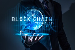 The abstract image of the business man hold the blockchain hologram on hand and element of this image furnished by Nasa. the concept of cryptocurrency, blockchain, internet of things and future life