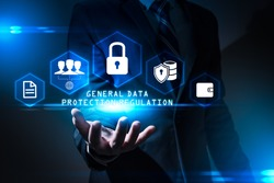 The abstract image of the business man hold the GDPR hologram on hand and. the concept of data, communications, privacy, internet of things and GDPR.