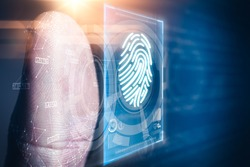 The abstract image of the businessman use a thumb scanning overlay with futuristic hologram. the concept of fingerprint, biometric, information technology and cyber security.