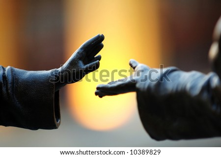 The abstract pose of hands over blur background