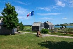 The Acadian flag in a village in Prince Edward Island, Canada