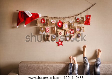 the advent calendar hanging on the wall. small gifts surprises for children. #1204140685