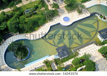 The aerial view of a modern garden pool.