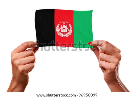 The Afghan flag in the woman hands. closeup