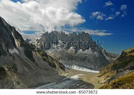 the 'aiguilles de chamonix' or the chamonix needles, above the mer de glace in the french alps, viewed from above the leschaux glacier