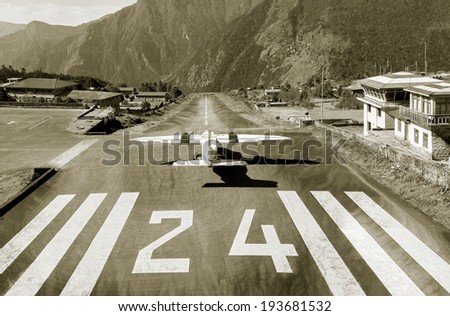 the aircraft on the runway of...