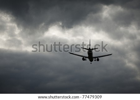 The airplane is landing in the bad weather