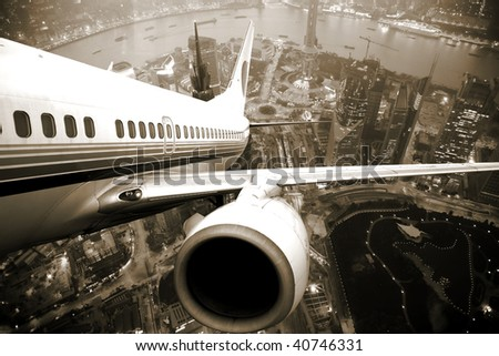 the airplane take off from the city night. - stock photo