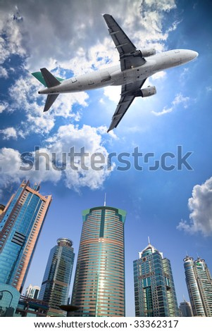 the airplane with the cit scene background.