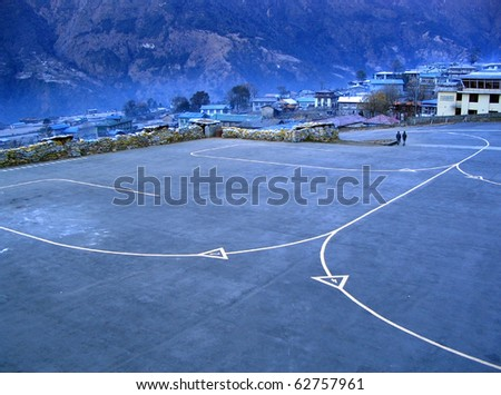 The airport at Lukla, the start of the trail to Mt Everest Base Camp, Nepal - stock photo