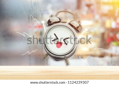 Stock Photo The alarm clock is happy in the morning at the bedroom. Good morning and Happy day. Have a good day concept.