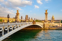 The Alexander III Bridge across Seine river in Paris, France at sunset