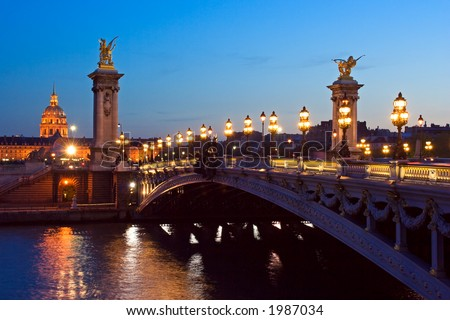 The Alexander III bridge and the dome of the Invalides at night - Paris, France