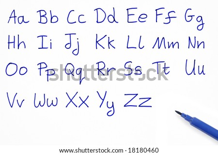The alphabet written on white paper with a blue felt tip pen.